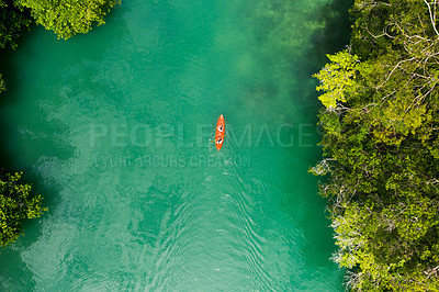 Buy stock photo High angle shot of two young women canoeing together in the beautiful oceans of Indonesia
