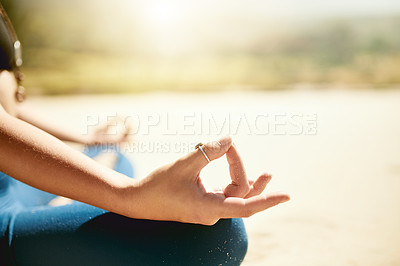 Buy stock photo Cropped shot of an unrecognizable woman practising yoga on the beach
