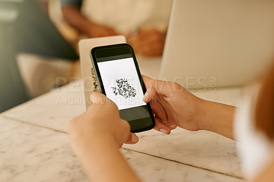 Buy stock photo Cropped shot of an unrecognizable young woman using NFC technology to pay in a cafe