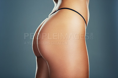 Buy stock photo Studio shot of an unrecognizable young woman posing in lingerie against a grey background