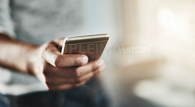 Buy stock photo Cropped shot of an unrecognizable woman using a cellphone