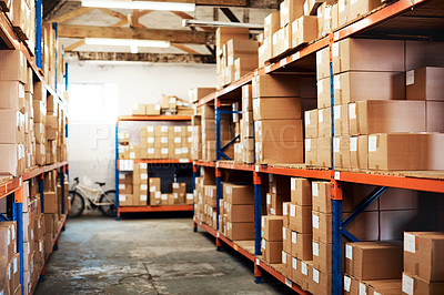 Buy stock photo Shot of boxes packed on shelves in a storage room