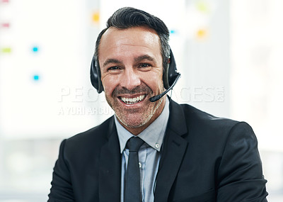 Buy stock photo Portrait of a mature businessman wearing a headset while working in an office