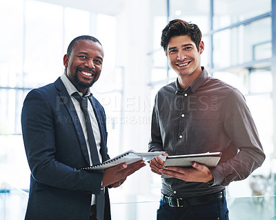Buy stock photo Cropped portrait of two young businessmen standing in a modern office