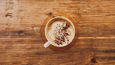 Buy stock photo Shot of a delicious hot beverage on a wooden table