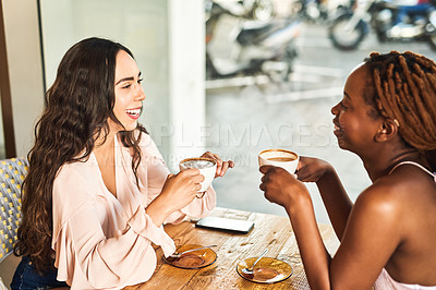 Buy stock photo Cropped shot of two female friends sitting together in a cafe