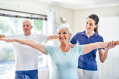 Buy stock photo Shot of an instructor assisting a senior woman in a fitness class