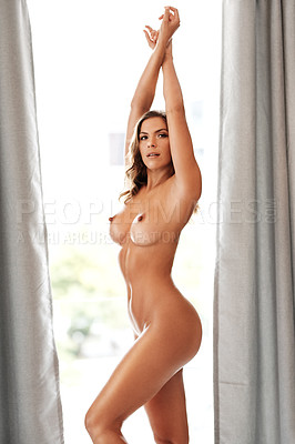 Buy stock photo Cropped portrait of a gorgeous young woman standing naked with her arms raised in her bedroom at home