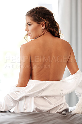 Buy stock photo Cropped shot of a gorgeous young woman sitting topless on her bed at home