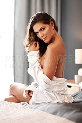 Buy stock photo Cropped portrait of a gorgeous young woman sitting topless on her bed at home
