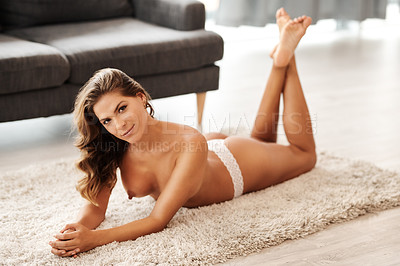 Buy stock photo Full length portrait of a gorgeous young woman lying topless on the floor in her living room at home