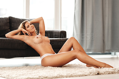 Buy stock photo Full length portrait of a gorgeous young woman sitting topless on the floor in her living room at home