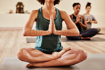 Buy stock photo Shot of a group of young women meditating in a yoga class