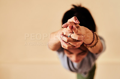 Buy stock photo Shot of a young women meditating during a yoga session