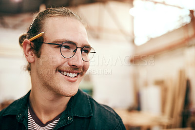 Buy stock photo Cropped shot of a handsome young carpenter working inside his workshop