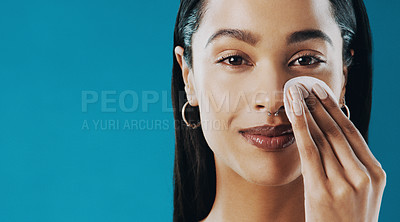 Buy stock photo Cropped shot of a beautiful young cleaning her face with a cotton pad
