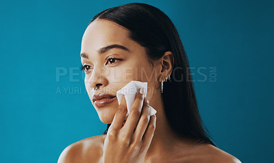 Buy stock photo Cropped shot of a beautiful young woman using a wet wipe to remove her makeup