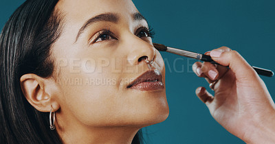 Buy stock photo Cropped shot of a beautiful young woman having her makeup done by an unrecognizable woman