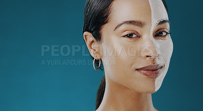 Buy stock photo Shot of a beautiful young woman wearing a facial mask on half of her face