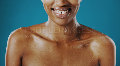 Buy stock photo Cropped shot of an unrecognizable woman posing with water droplets on her body