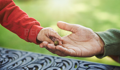 Buy stock photo Cropped shot of an unrecognizable boy giving his father a seed during a day out with him