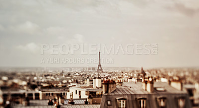 Buy stock photo Cropped shot of the famous Eiffel Tower overlooking the city of Paris in France