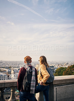 Buy stock photo Cropped shot of an unrecognizable young couple enjoying a day of sightseeing together in Paris