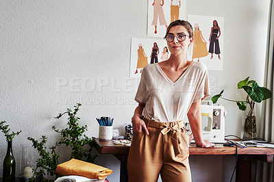 Buy stock photo Shot of a young fashion designer in her workshop