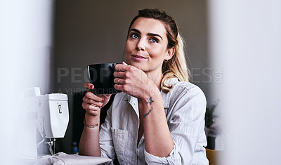 Buy stock photo Cropped shot of a fashion designer having coffee at her desk