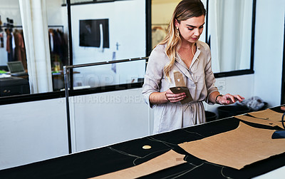 Buy stock photo Cropped shot of a young fashion designer working working on new patterns
