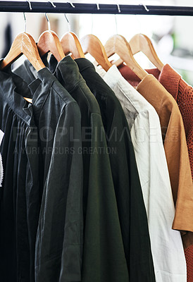 Buy stock photo Cropped shot of clothes hanging on a railing