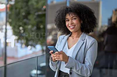 Buy stock photo Portrait of an attractive young businesswoman using a cellphone while standing outside her office building