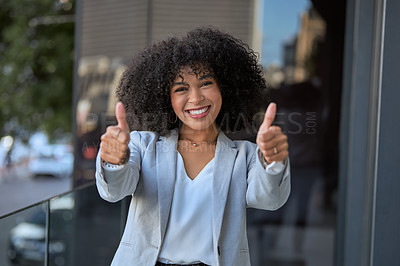 Buy stock photo Portrait of an attractive young businesswoman posing with her thumbs up outside her office building