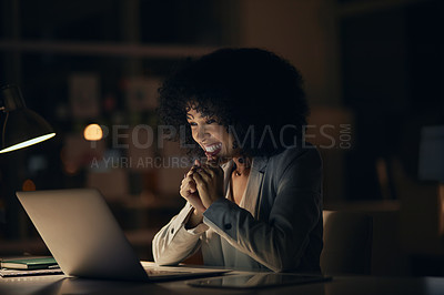Buy stock photo Cropped shot of an attractive young businesswoman feeling cheerful and excited while working late in her office at night