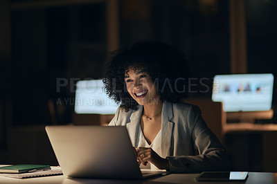 Buy stock photo Cropped shot of an attractive young businesswoman working on a laptop during a late night at the office
