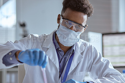 Buy stock photo Shot of a young scientist working with samples in a lab