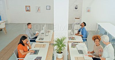 Buy stock photo Shot of a group of diverse businesspeople working in a modern office