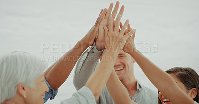 Buy stock photo Shot of a group of diverse businesspeople joining hands in solidarity in a modern office