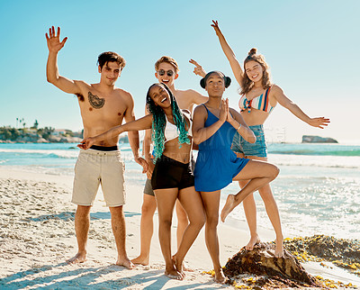 Buy stock photo Shot of a group or friends spending the day at the beach