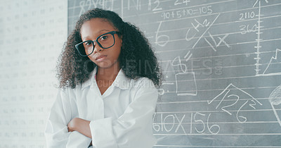 Buy stock photo Portrait of a confident young girl in a mathematics class at school