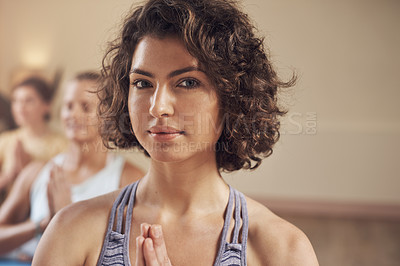 Buy stock photo Cropped portrait of a young group of women sitting together and meditating after an indoor yoga session