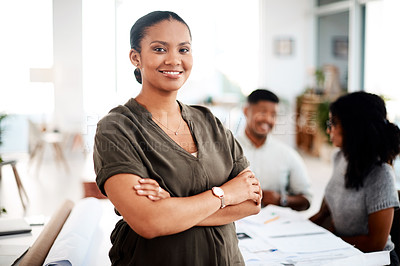 Buy stock photo Portrait of a confident young businesswoman standing in front of a team of architects