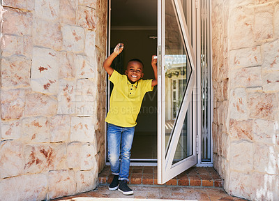 Buy stock photo Full length portrait of an adorable little boy smiling while holding keys to his new home