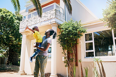 Buy stock photo Cropped shot of an affectionate young single father playfully lifting his son in their front yard at home