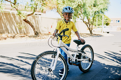 Buy stock photo Full length portrait of a handsome young boy getting ready to ride a bicycle outdoors