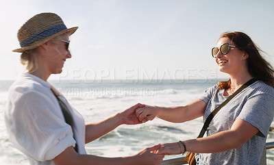 Buy stock photo Cropped shot of a happy young couple dancing and enjoying themselves outdoors near the beach