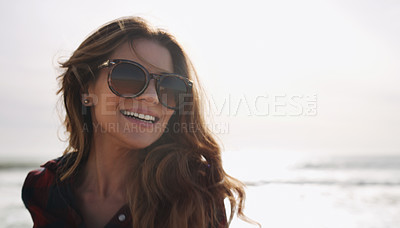 Buy stock photo Cropped shot of a beautiful woman enjoying herself at the beach