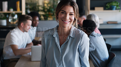 Buy stock photo Portrait of a confident young businesswoman in in the office boardroom with her colleagues in the background