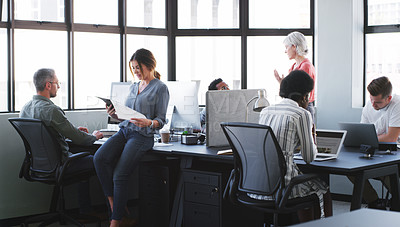 Buy stock photo Shot of a team of diverse businesspeople working together in a modern office