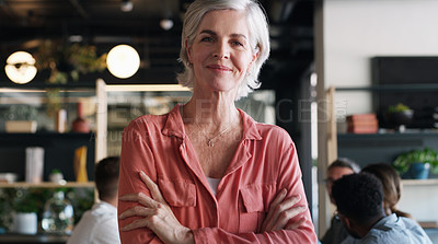 Buy stock photo Portrait of a confident mature businesswoman in in the office boardroom with her colleagues in the background
